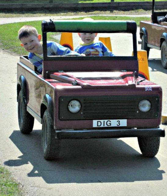 The boys driving a landrover at Diggerland