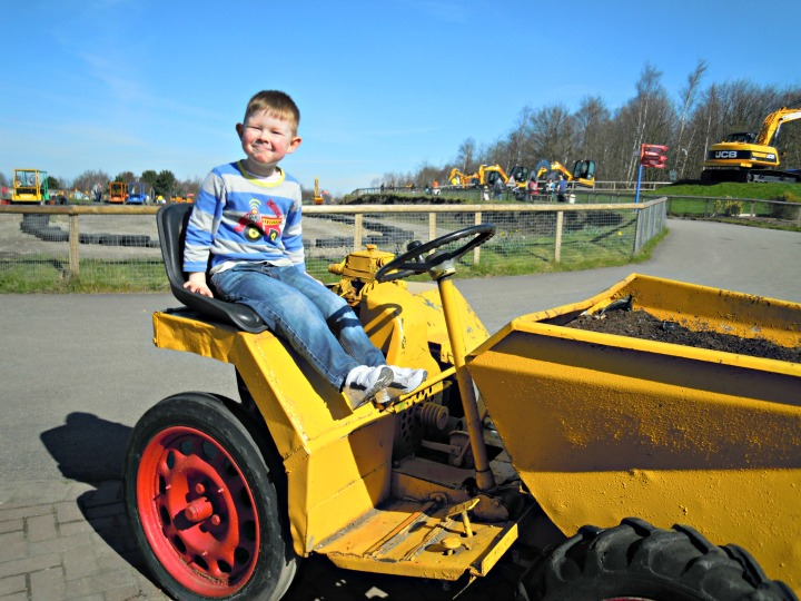 4 year old on a Dumper truck at Diggerland