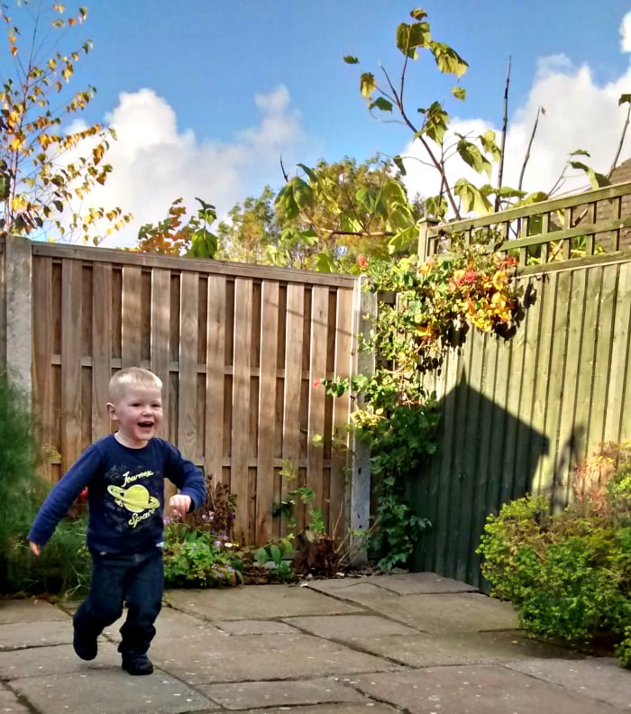 Daniel playing in the garden at Oakwood Mews cottage