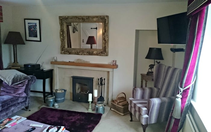 Relax in the sitting room at Evergreen Cottage