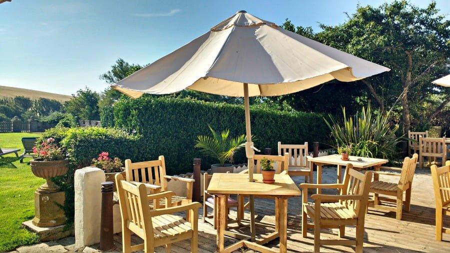 Outdoor eating area at Moonfleet Manor